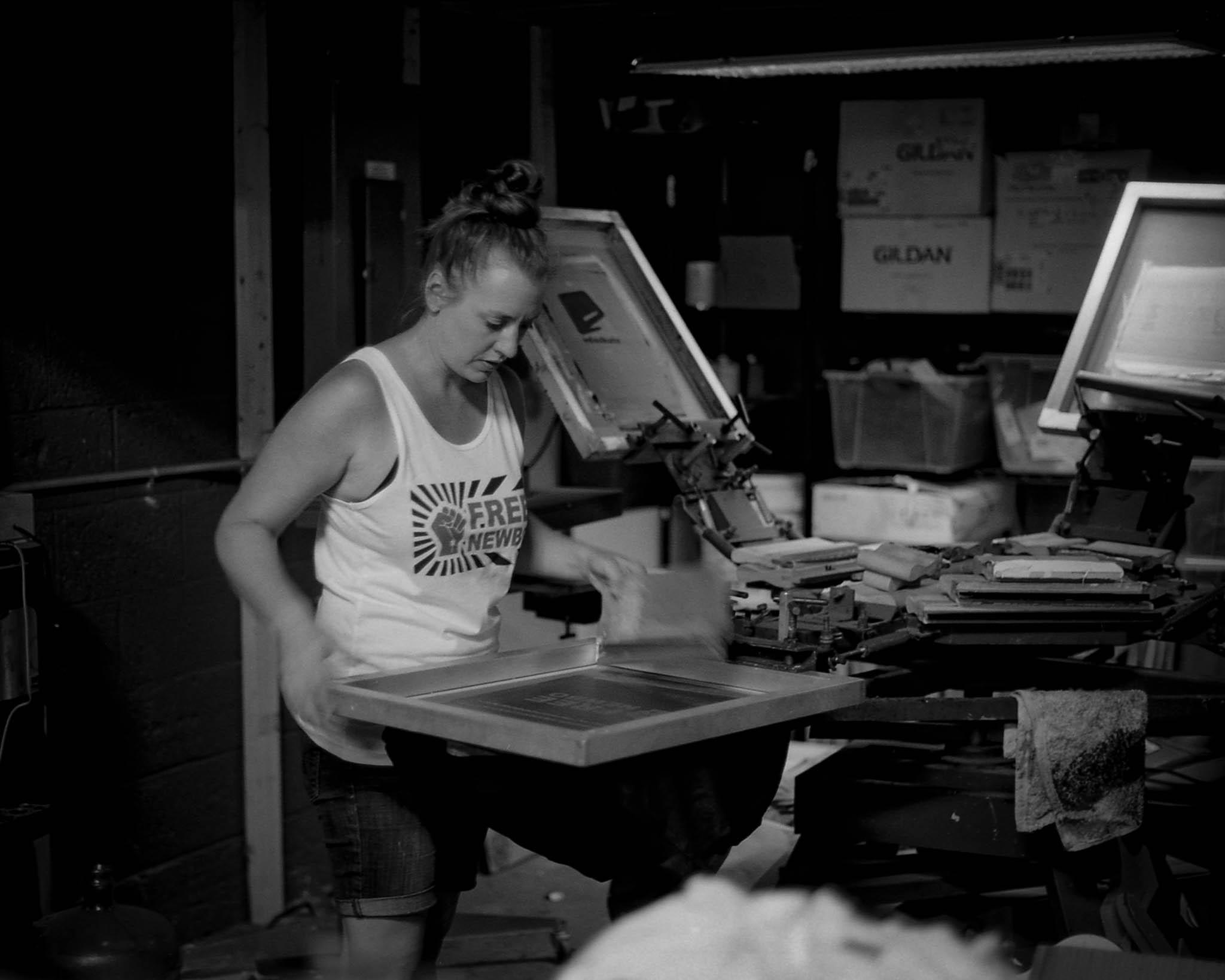 Lindsey printing a Free New Bo shirt at Eduskate