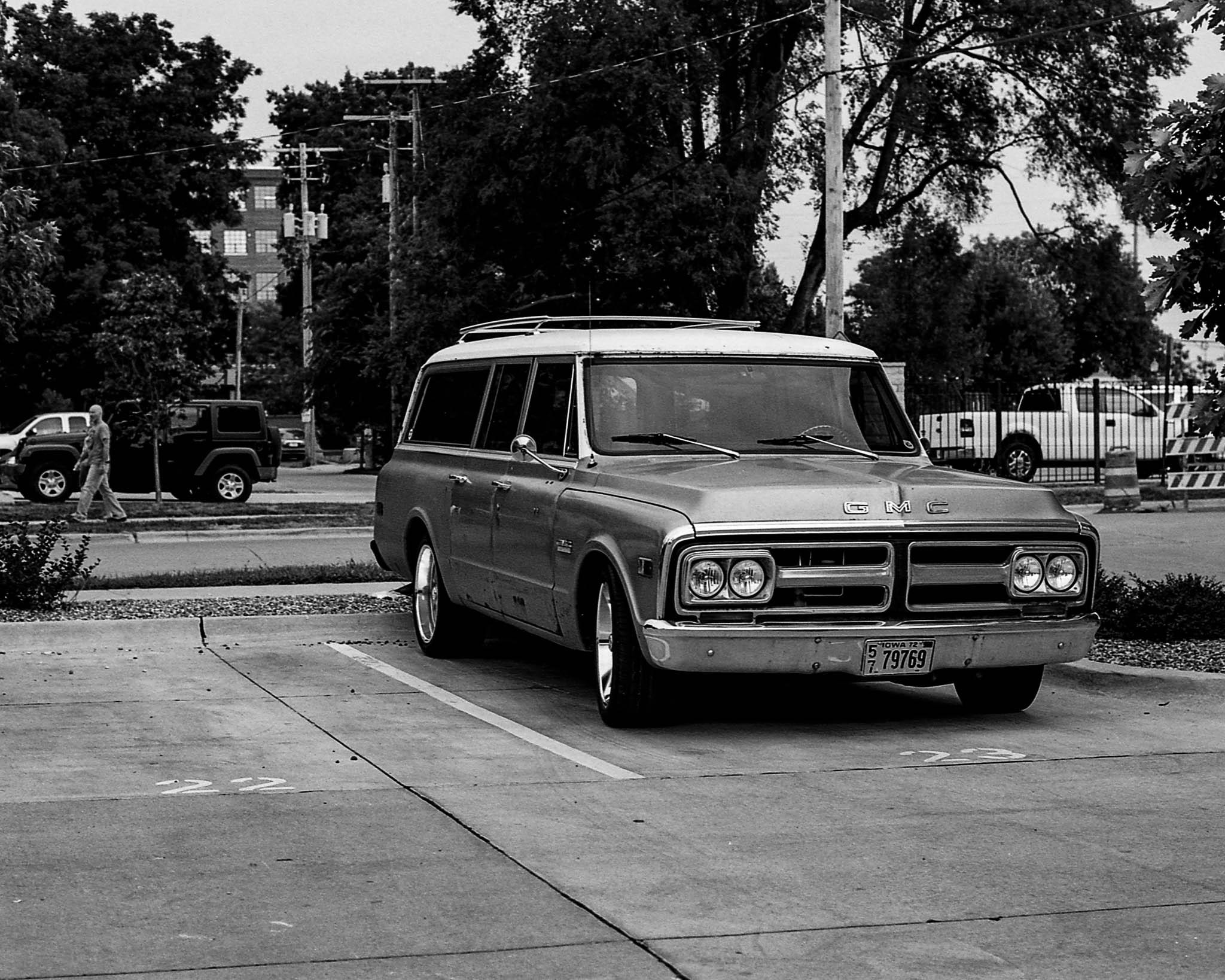 An old GMC station wagon parked outside Analog Vault in the New Bo neighborhood