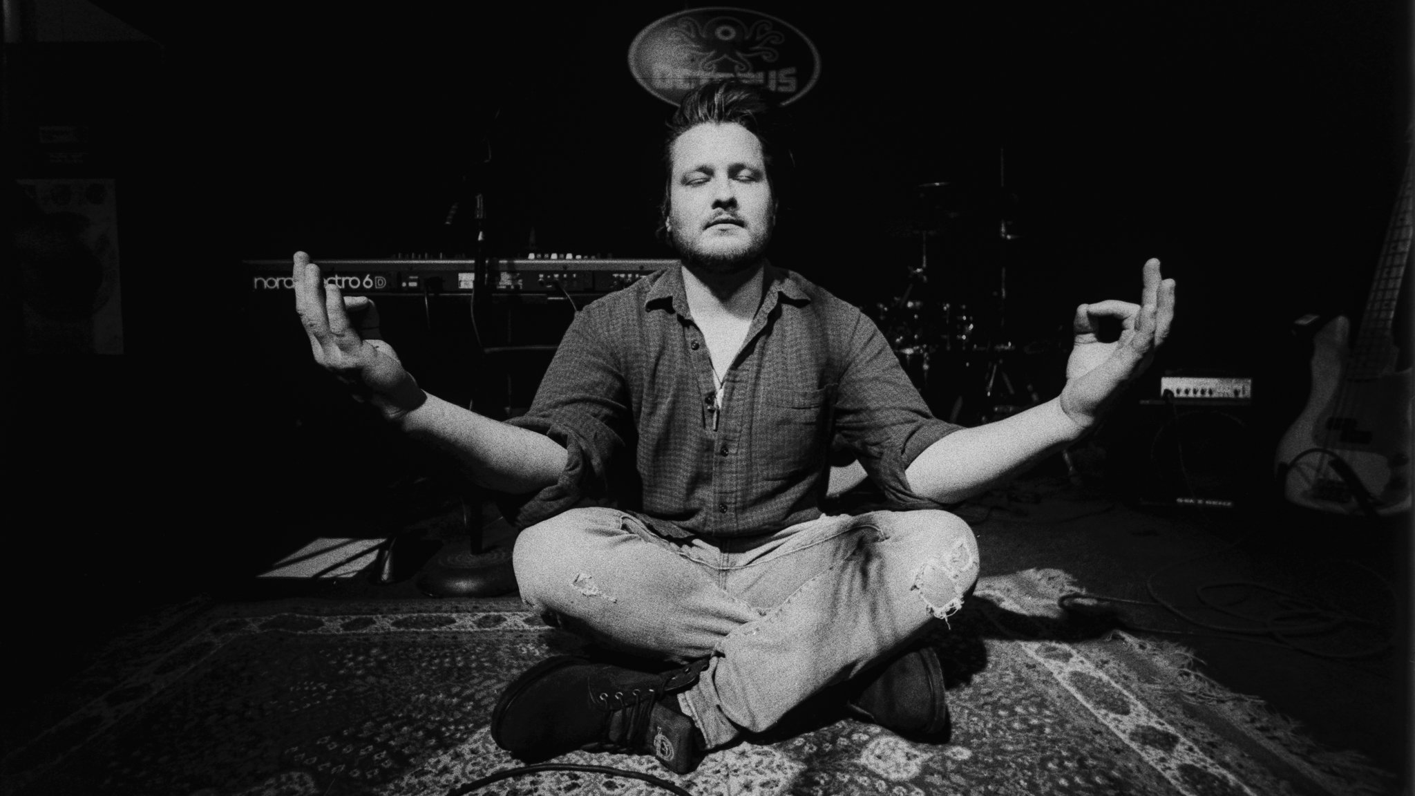 Eric Paul meditating before the show at The Octopus in Cedar Falls, Iowa