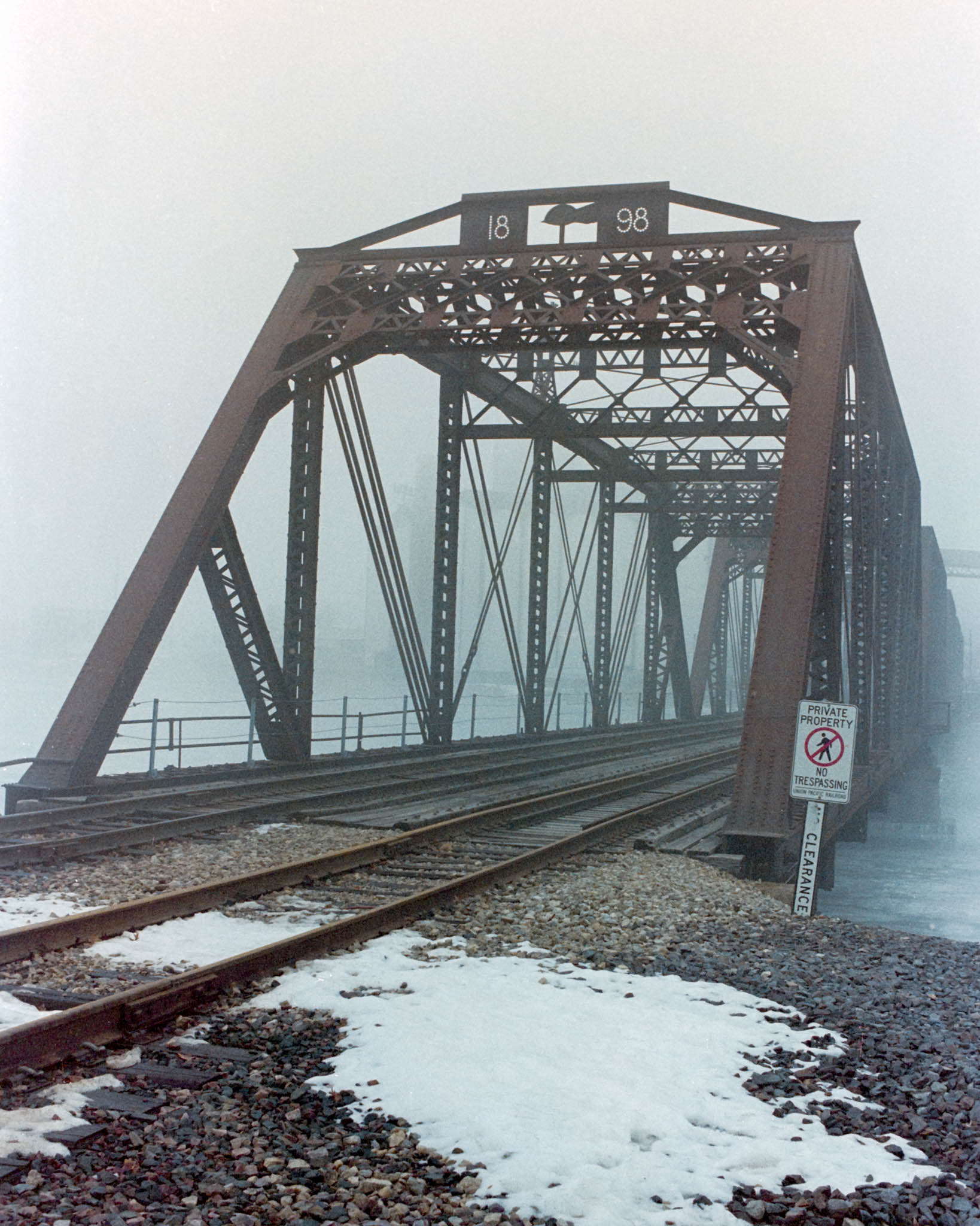 Quaker Oats railroad bridge in Cedar Rapids on a foggy winter day. Camera: Nikon N2020 with Fujifilm Superia 400