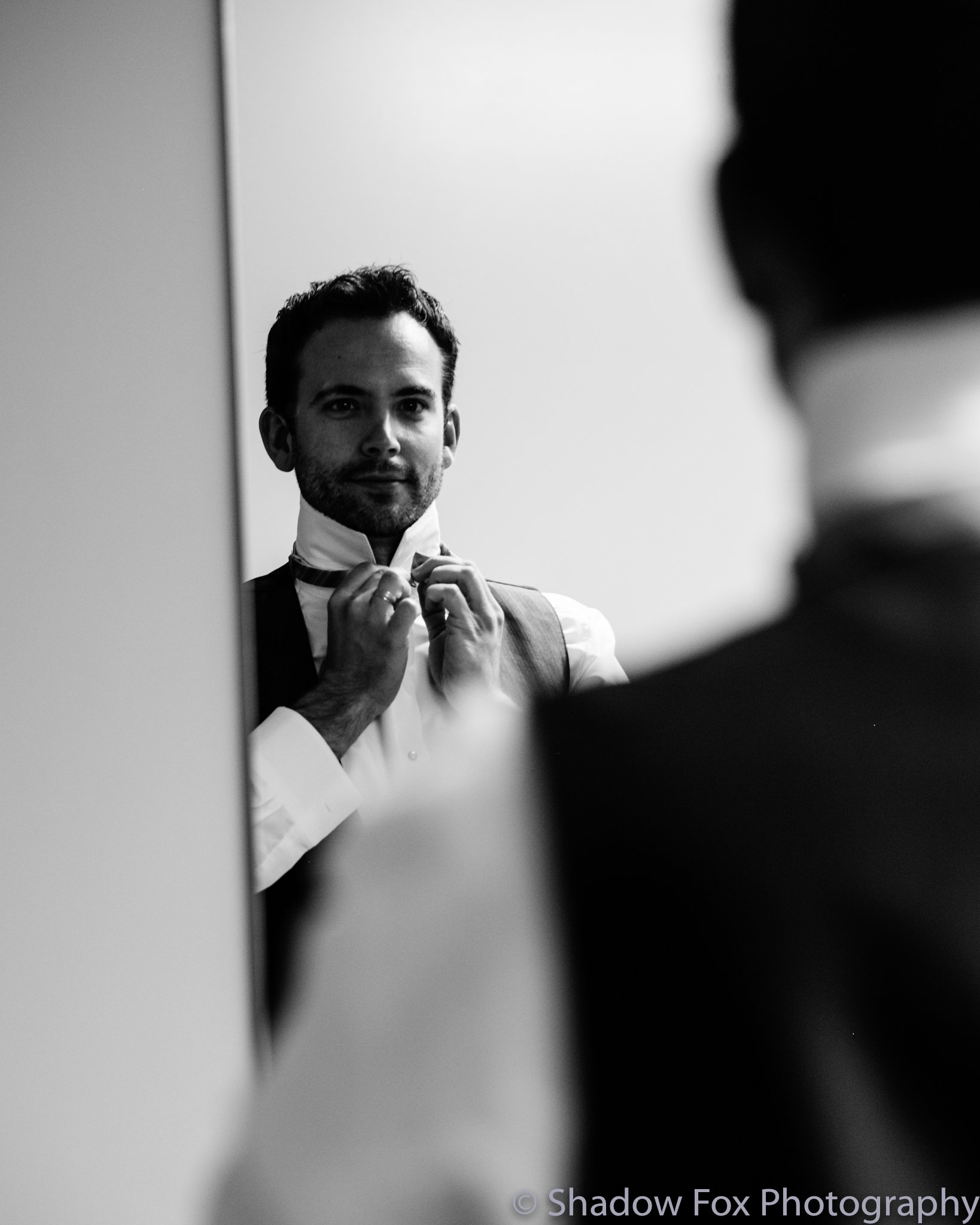 Photo of the groom getting ready for the wedding