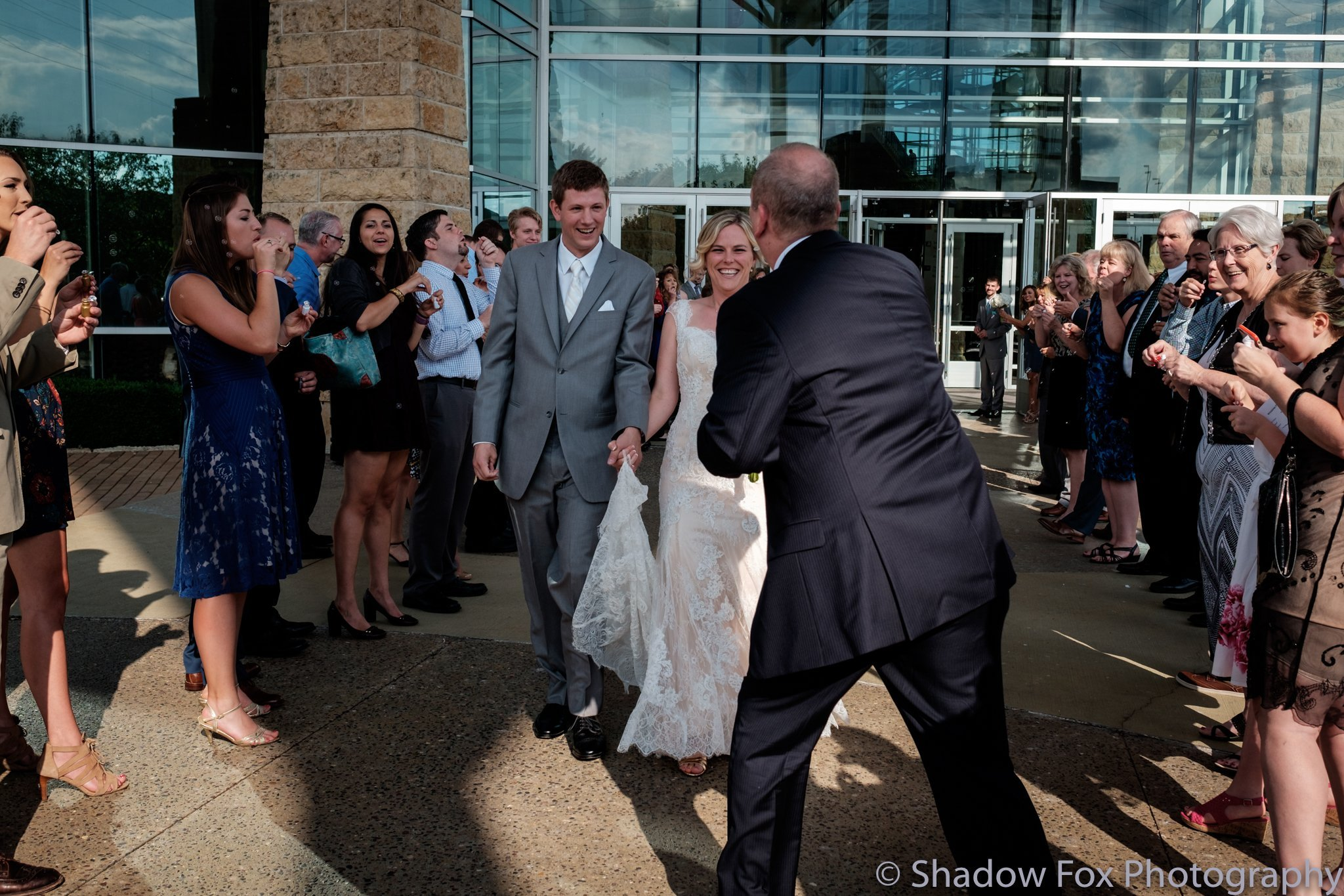 Family congratulating couple after wedding