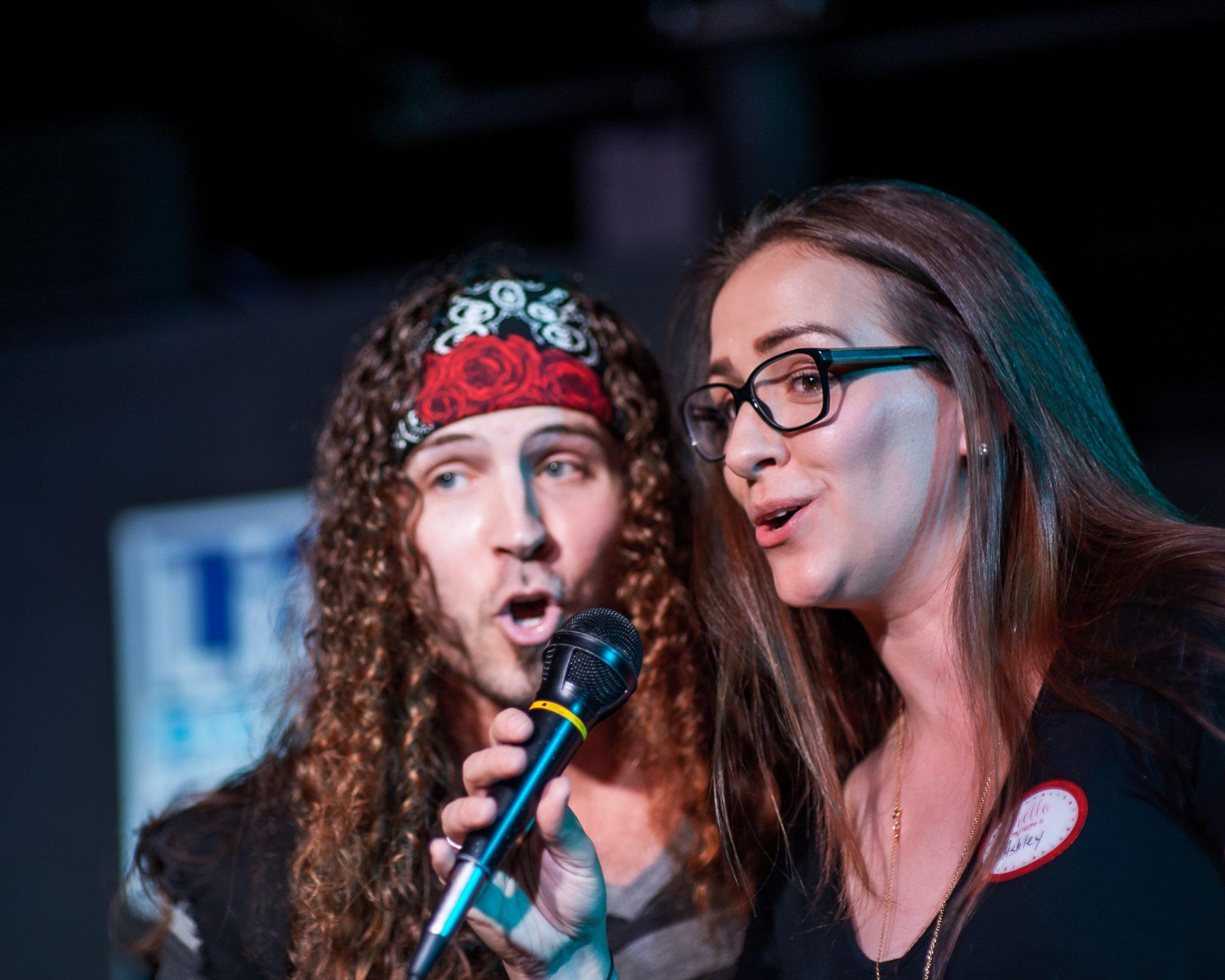 Cedar Rapids city council member Ashley Vanorny singing at State Representative Liz Bennett's Celebrity Karaoke Night Fundraiser