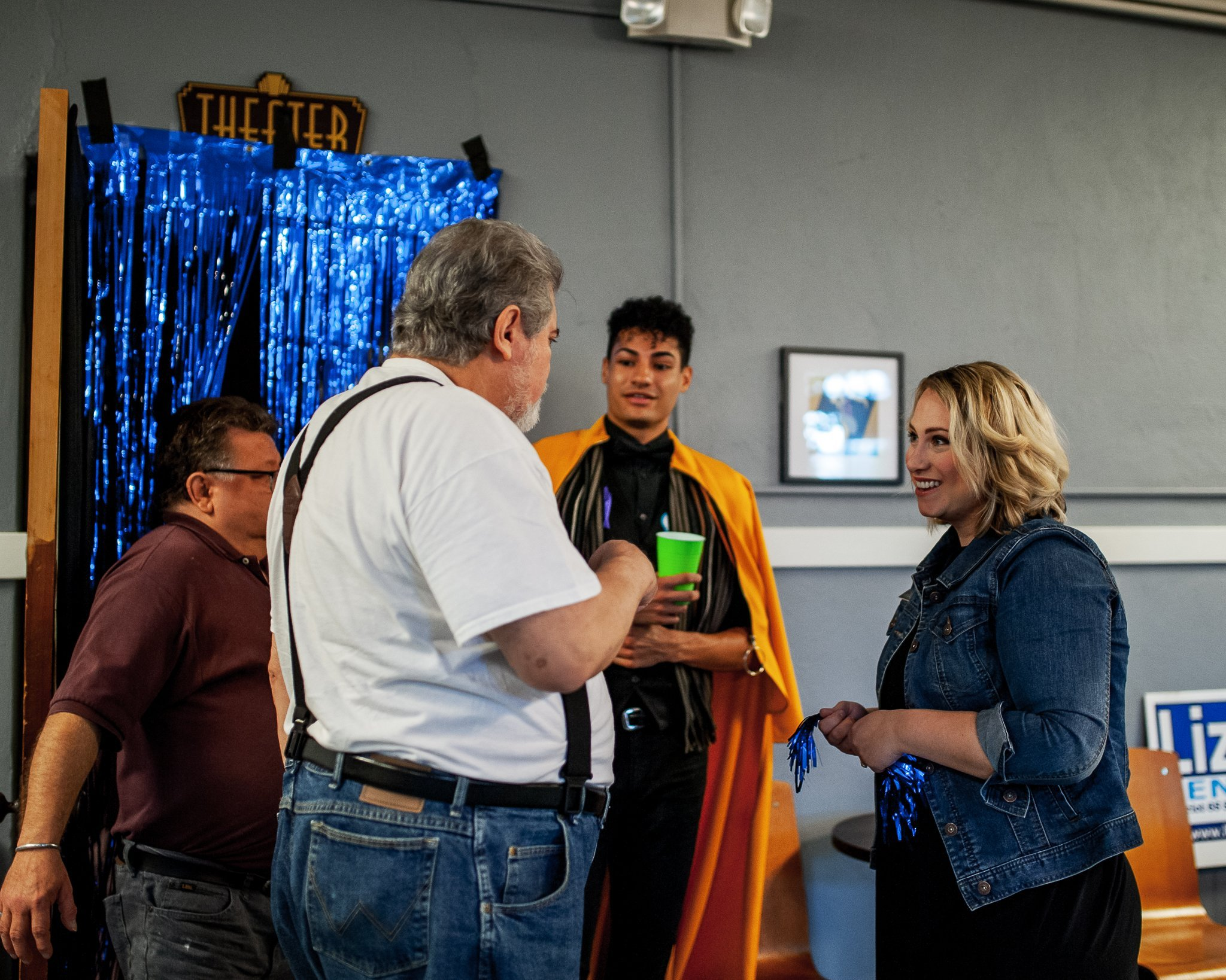 State Representative Liz Bennett talking with supporters at her Celebrity Karaoke Night Fundraiser at the Rich Heritage of Cedar Rapids Theatre Company