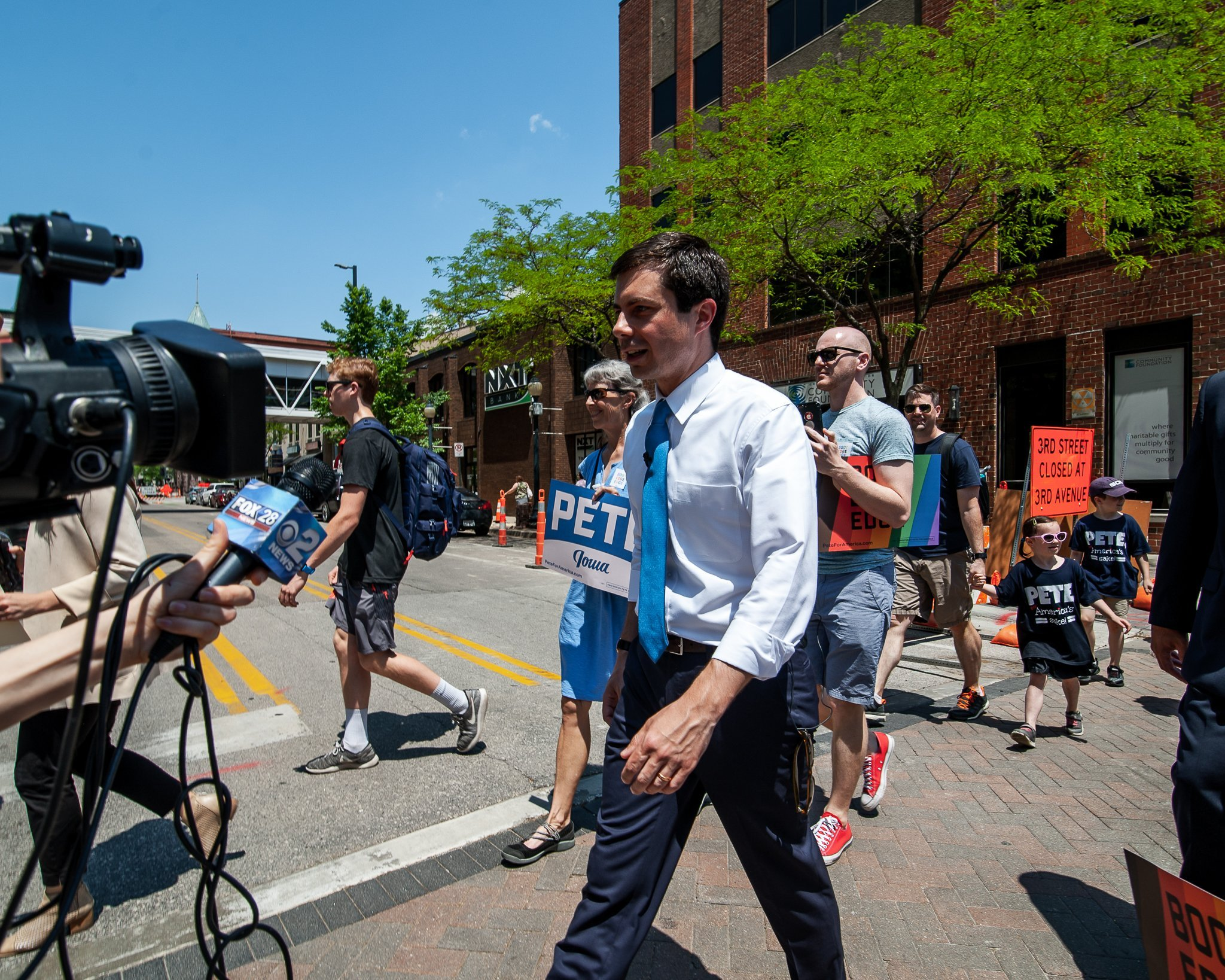 Pete Buttigieg supporters march from Green Square Park to the U.S. Cellular Center in downtown Cedar Rapids, Iowa
