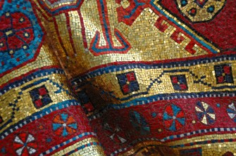 A detail of the mosaic Oriental carpet draped over Rudolf Nureyev's tomb in a Russian Cemetery in France. ©http://parisandbeyond-genie.blogspot.co.uk/2011/11/pilgrimage-to-saint-genevieve-des-bois.html