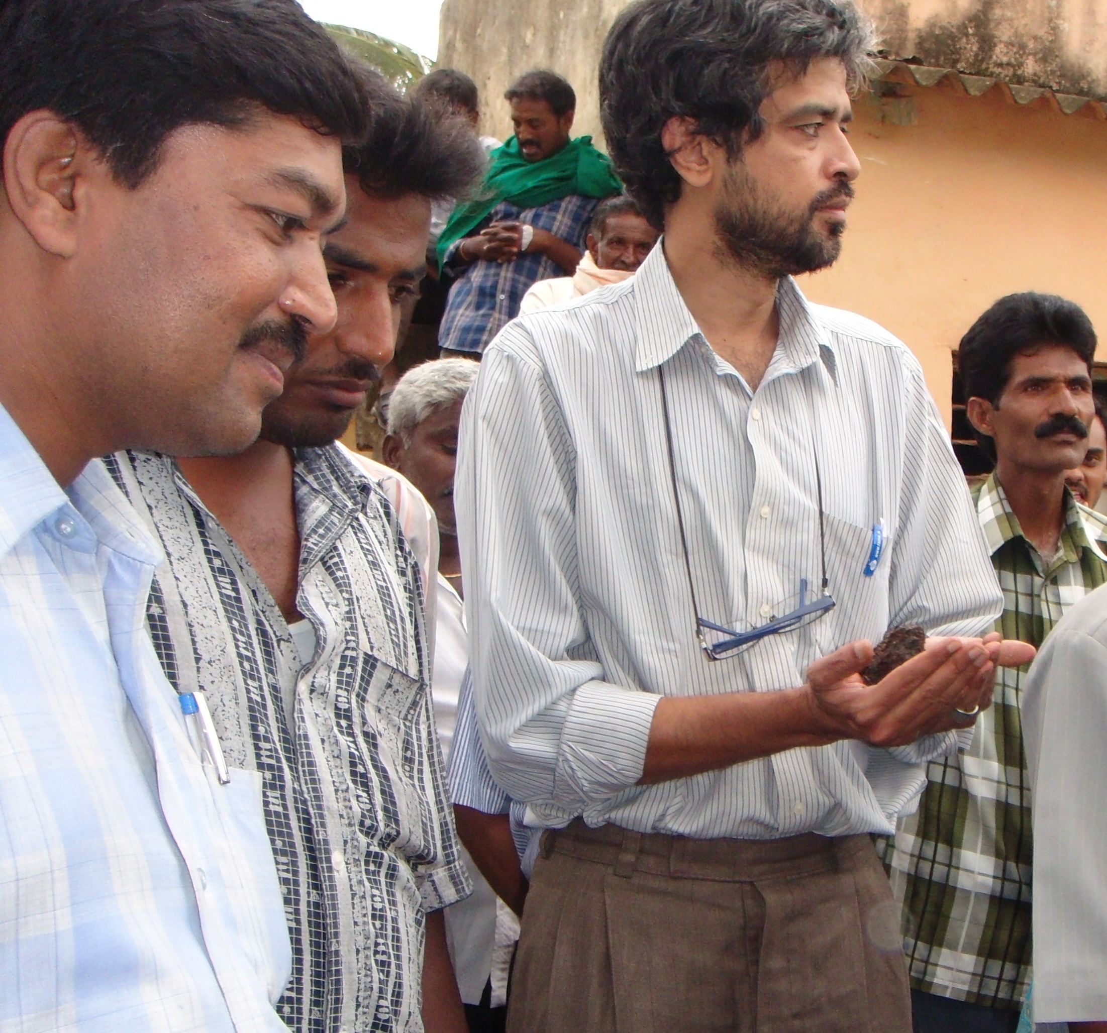 Mr. Vishwanth holding compost (from human waste) in hands