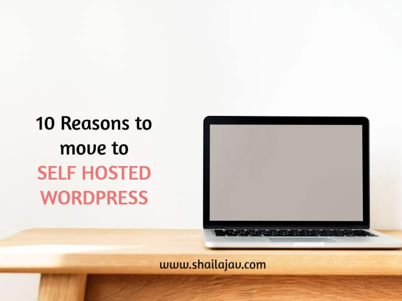 Laptop on table. text: Why you should move to self hosted WordPress