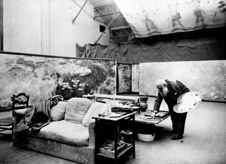 Claude Monet painting 'Les Nymphéas' at his studio in Giverny.