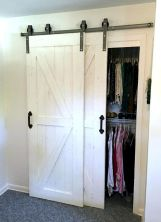 Barn style sliding doors applied as bedroom doors showing a rustic accent in the modern country homes Image 15