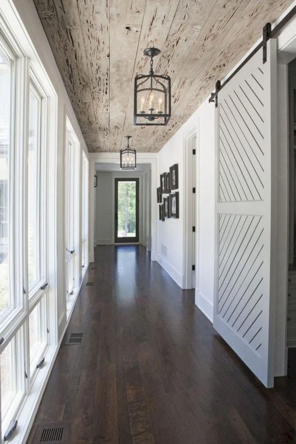 Barn style sliding doors applied as bedroom doors showing a rustic accent in the modern country homes Image 19