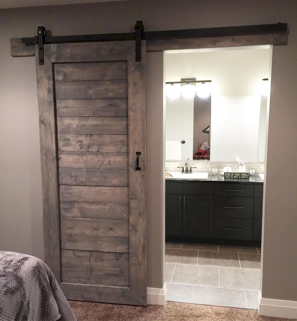 Barn style sliding doors applied as bedroom doors showing a rustic accent in the modern country homes Image 2