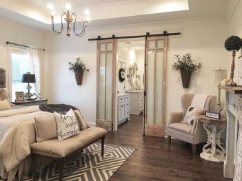 Barn style sliding doors applied as bedroom doors showing a rustic accent in the modern country homes Image 22