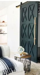 Barn style sliding doors applied as bedroom doors showing a rustic accent in the modern country homes Image 23