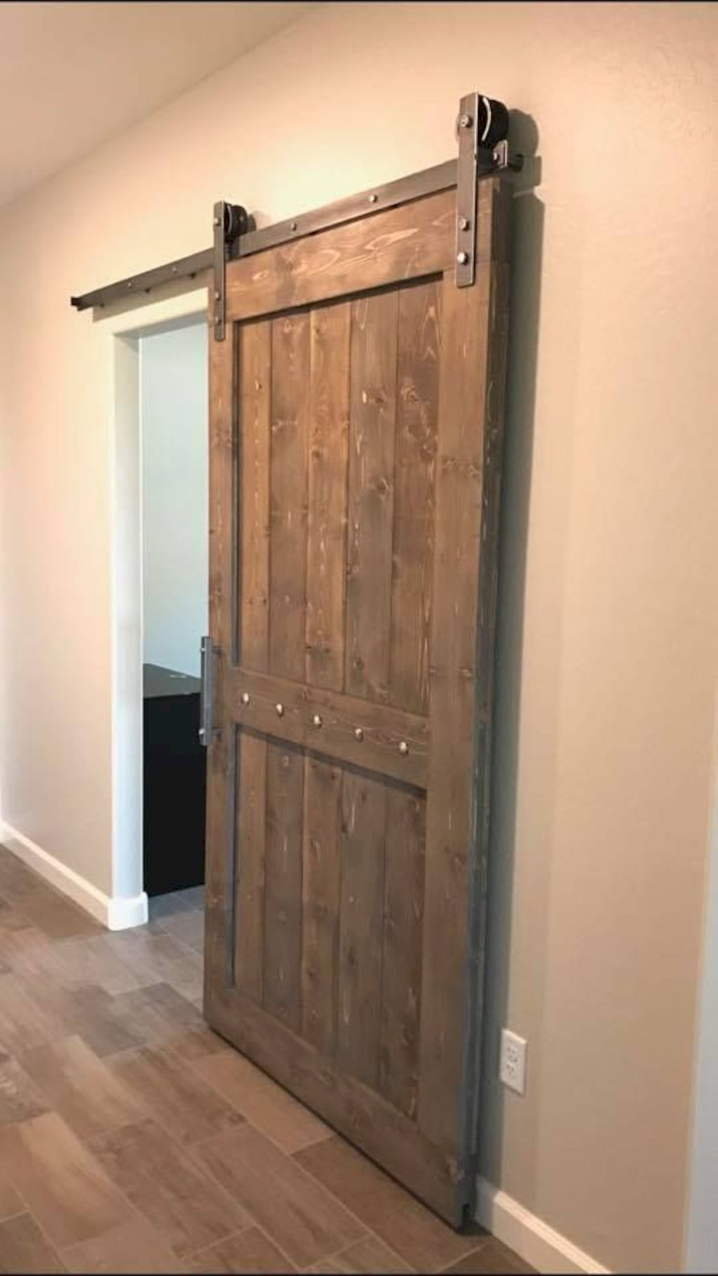 Barn style sliding doors applied as bedroom doors showing a rustic accent in the modern country homes Image 33