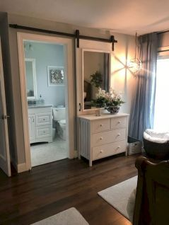 Barn style sliding doors applied as bedroom doors showing a rustic accent in the modern country homes Image 8