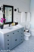 Beautiful bathroom update with eclectic patterned tiles and ethnic rugs very efficient to improve bathroom floor design Image 33
