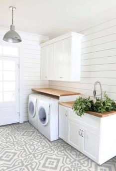 Classy laundry room update with first class finishing to make a functional room that looks elegant and stylish Image 3