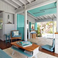 Coastal cottage living area with pure bright schemes outlooking vast sea view giving a complete beach style home Image 13
