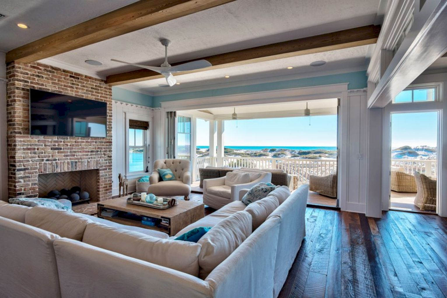 Coastal cottage living area with pure bright schemes outlooking vast sea view giving a complete beach style home Image 19