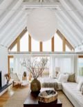 Coastal cottage living area with pure bright schemes outlooking vast sea view giving a complete beach style home Image 9