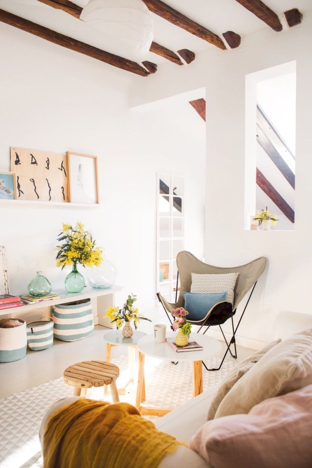 Minimalist living room update inspired by cottage living area showing a natural characteristic of beach style home Image 42