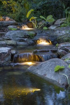 Best small waterfall designs giving the best natural refreshment in such a brilliant backyard with water features Image 21
