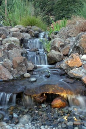 Best small waterfall designs giving the best natural refreshment in such a brilliant backyard with water features Image 22