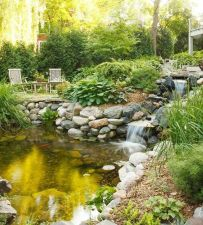 Best small waterfall designs giving the best natural refreshment in such a brilliant backyard with water features Image 24