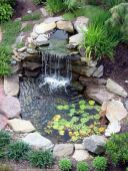 Best small waterfall designs giving the best natural refreshment in such a brilliant backyard with water features Image 26