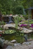 Best small waterfall designs giving the best natural refreshment in such a brilliant backyard with water features Image 27