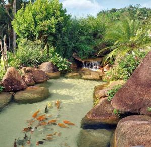 Best small waterfall designs giving the best natural refreshment in such a brilliant backyard with water features Image 29