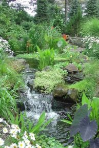 Best small waterfall designs giving the best natural refreshment in such a brilliant backyard with water features Image 30