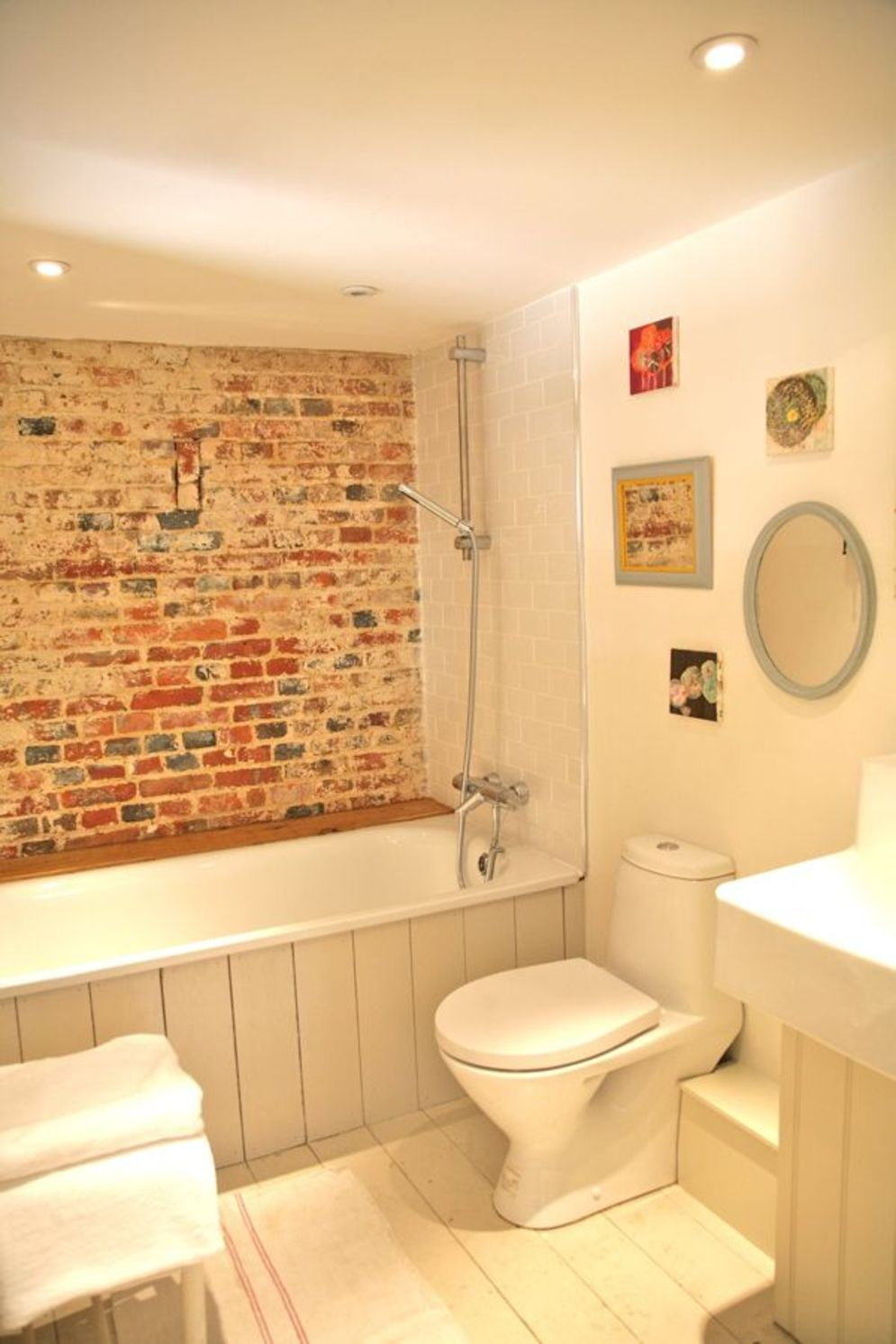 Cozy bathroom update adapting brick wall accents showing charm and friendly finish Image 14