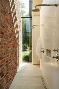 Cozy bathroom update adapting brick wall accents showing charm and friendly finish Image 17