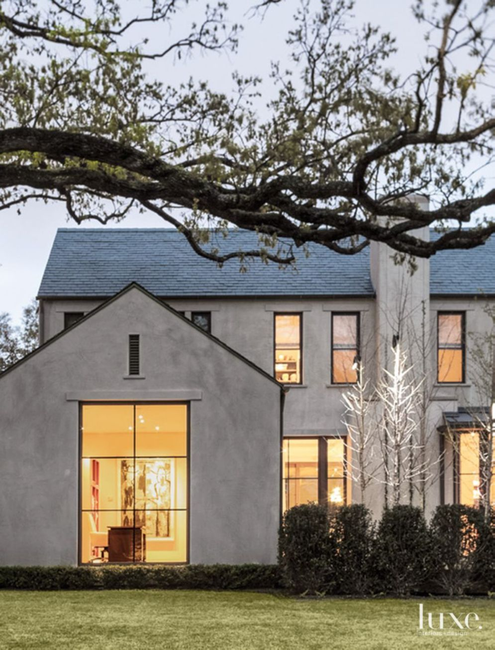 Modern house with new farmhouse exterior design pulling out country charm and warm welcoming display Image 25
