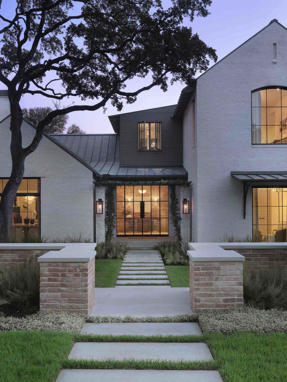 Modern house with new farmhouse exterior design pulling out country charm and warm welcoming display Image 40