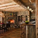 Rustic cabin kitchen designs showing warm wooden structure in earthy natural palettes Image 12