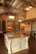 Rustic cabin kitchen designs showing warm wooden structure in earthy natural palettes Image 13