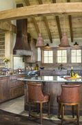 Rustic cabin kitchen designs showing warm wooden structure in earthy natural palettes Image 14
