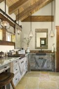 Rustic cabin kitchen designs showing warm wooden structure in earthy natural palettes Image 15