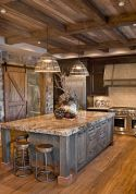 Rustic cabin kitchen designs showing warm wooden structure in earthy natural palettes Image 20