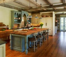 Rustic cabin kitchen designs showing warm wooden structure in earthy natural palettes Image 24