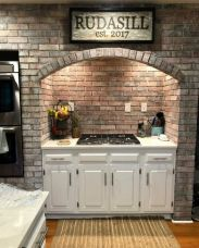Rustic cabin kitchen designs showing warm wooden structure in earthy natural palettes Image 5