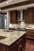 Warm and friendly cabin kitchen displaying rustic interior styles providing ideal space for a perfect retreat Image 31
