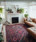 Artful interior style showcasing eclectic Bohemian display with ethnic rugs as decoration Image 11