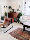 Artful interior style showcasing eclectic Bohemian display with ethnic rugs as decoration Image 5