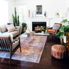 Artful interior style showcasing eclectic Bohemian display with ethnic rugs as decoration Image 7
