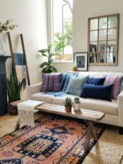 Artful interior style showcasing eclectic Bohemian display with ethnic rugs as decoration Image 8