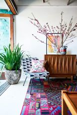 Artful interior style showcasing eclectic Bohemian display with ethnic rugs as decoration Image 9